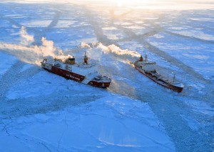 Coast Guard Cutter Healy and Russian Tanker Renda breaking ice south of Nome, Alaska - Credit: USCG