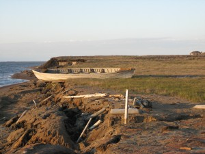 A USGS researcher took a picture of this nearly century-old whaling boat in July 2007 along the Beaufort Sea coast near Lonely, Alaska. The boat washed away to sea just a few months later. Courtesy of Benjamin Jones, USGS
