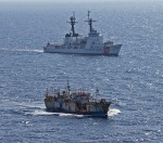 CG Cutter Rush escorts suspected high seas drift net fishing vessel Da Cheng in the North Pacific – Photo by USCG