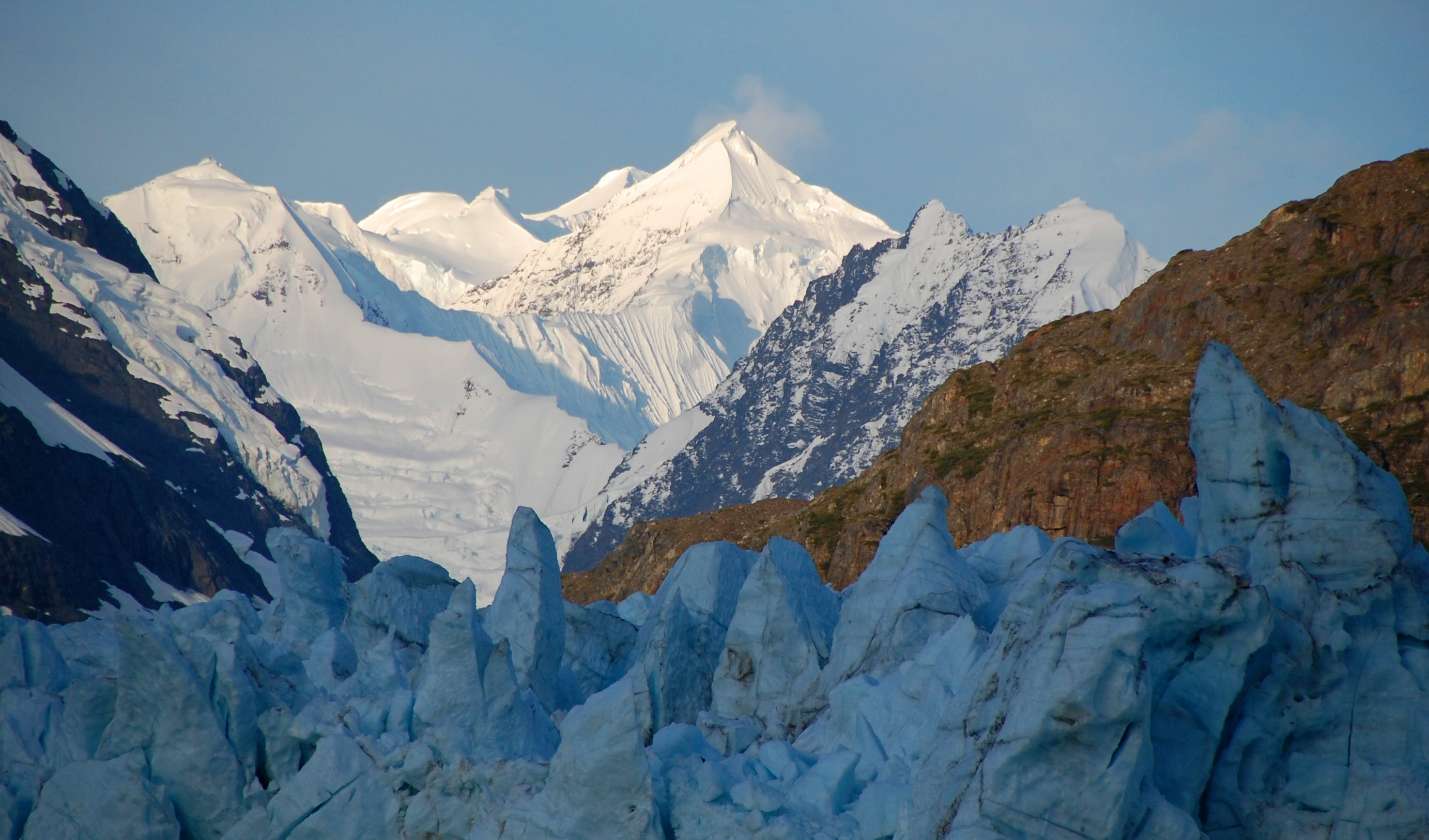 Sunrise on the Fairweather Mountain peaks over the Margerie Glacier - Photo by NPS