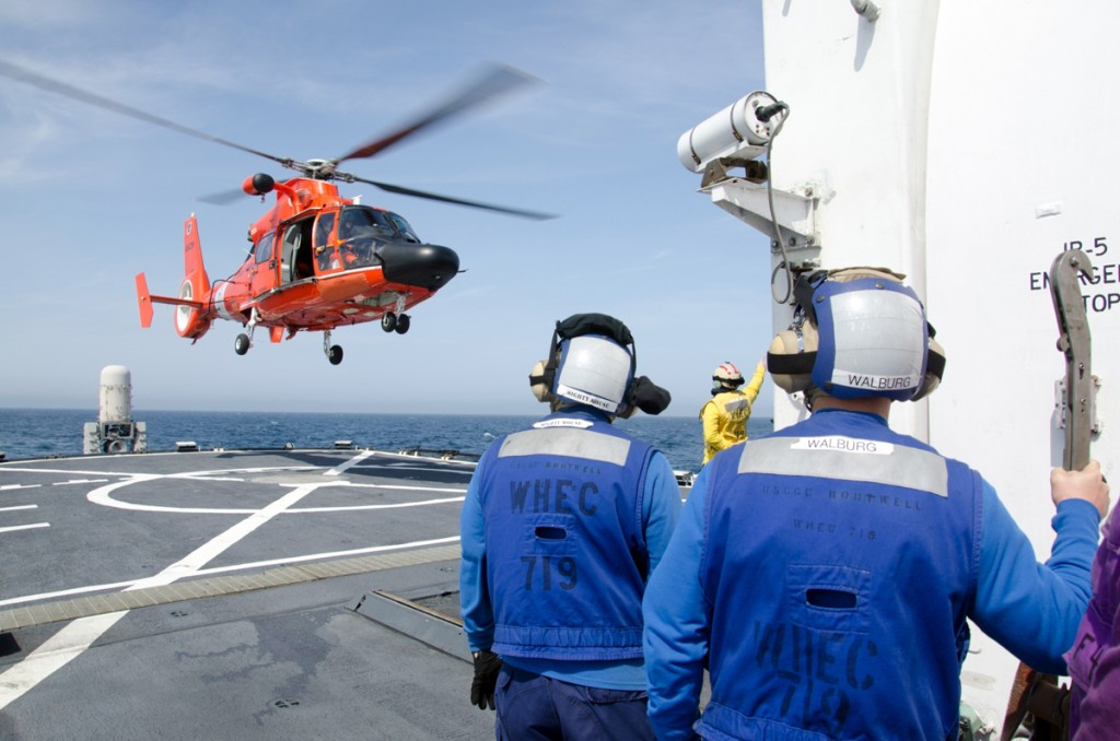 A Coast Guard MH-65 Dolphin departs Coast Guard Cutter Boutwell for a fisheries enforcement flight 25 nautical miles off Unimak Island in the Aleutian Islands, Alaska, June 27. (U.S. Coast Guard Photo)