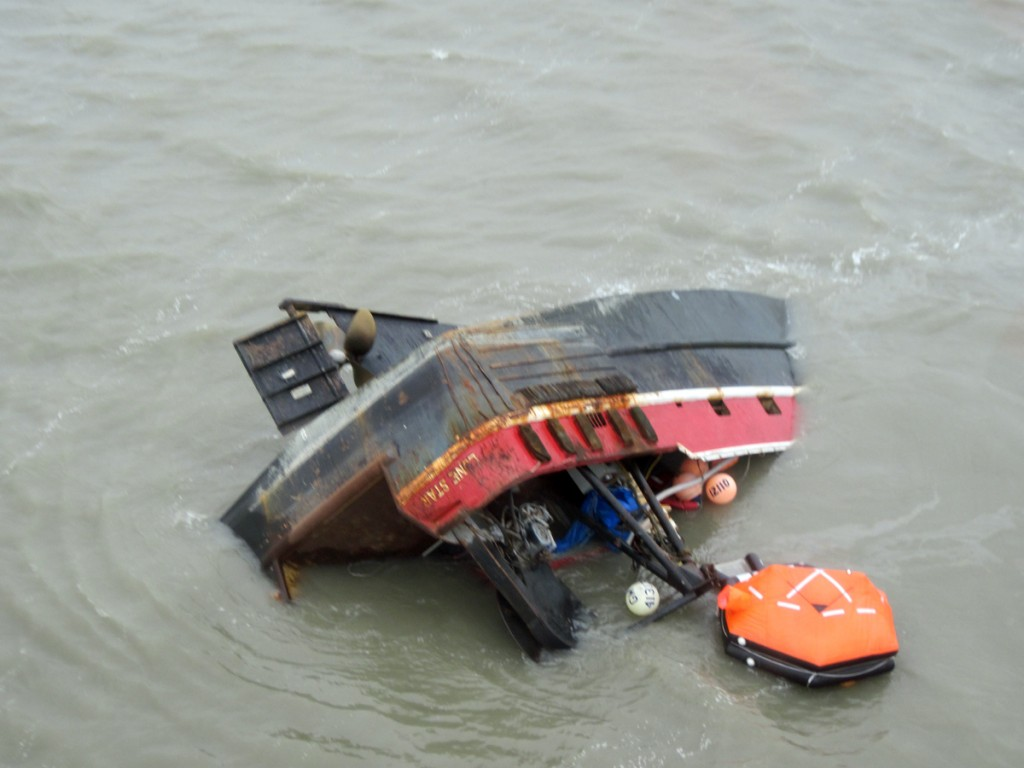 Fish tender Lone Star grounded in the Igushik River, Nughagak Bay